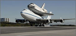 The space shuttle Endeavour returns atop a NASA 747 aircraft to the Kennedy Space Center in December.