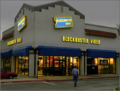 A customer walks to Blockbuster Video rental store in Richardson, Texas. The company's deal with CinemaNow will give customers another option for renting movies without going to a store.