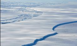 The Wilkins Ice Shelf off the Antarctic Peninsula is seen breaking up January 18, 2009. The huge Antarctic ice shelf is on the brink of collapse with just a sliver of ice holding it in place, the latest victim of global warming that is altering maps of the frozen continent.