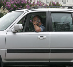 A man talks on his cellphone while driving in Washington, D.C.