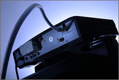 A cable box sits on top of a television in Philadelphia. While a weak economy invariably makes people pinch pennies, this is the first time that viewing shows online has become a viable competitor to pay TV, making cutting the cord easier.