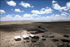 A $6 million pilot plant for extracting lithium from the salt flats of Uyuni, in the town of Rio Grande, Bolivia is shown on Tuesday, Jan. 27, 2009. The flats are believed to hold more than half the world's reserves of lithium, the key component for electronics batteries and electric car batteries. The Evo Morales government wants to avoid letting foreign corporations earn all the profit from Bolivia's natural resources, setting the stage for a showdown over the lithium reserves.