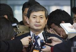 South Korea's stem cell scientist Hwang Woo-Suk speaks to reporters at the Seoul National University on December 23, 2005 in Seoul. Woo-Suk resigned from his position as a university professor after his school stated that he had damaged the scientific community by fabricating the results of at least nine of 11 stem-cell lines he claimed to have created.