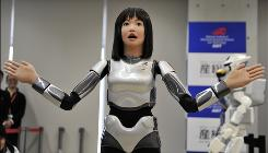 "Japan's government sponsored research laboratory AIST unveils its new humanoid robot """"HRP-4C"".   The HRP-4C, called Cybernetic Human, which has 42 actuators and several sensors on its body, will debut at a fashion show of the Tokyo collection later this month."