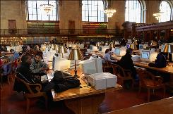 People work on computers in one of the reading rooms at the New York Public Library December 15, 2004.
