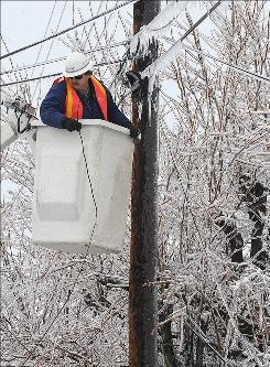 Greg Sears, an AT&T employee, works Friday, Jan. 30, 2009 to restore service on a phone line in Danville, Ky after a crippling winter storm.