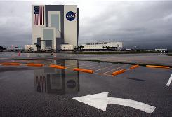 Storm clouds approach the Vehicle Assembly Building at the Kennedy Space Center. Thunderstorms will keep the space shuttle up an extra day.