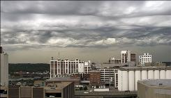 This June 20, 2006 photo provided on Monday, June 8, 2009 and taken by Jane Wiggins from a downtown Cedar Rapids, Iowa office building shows what may become the first new cloud type to be recognized by scientists since 1951.