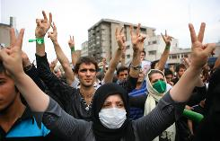 Iranian supporters of presidential candidate Mir Hossein Mousavi demonstrate in the streets of Tehran. As the government cracks down on traditional media after the disputed presidential election, tech-savvy Iranians have turned to Twitter.