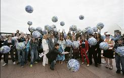 Australians take part in a Flash Mob at the Landcare Australia World Environment Day launch luncheon at Quayside Brassiere on June 5, 2009 in Sydney. A science fiction writer first predicted flash mobs in a 1973 book.