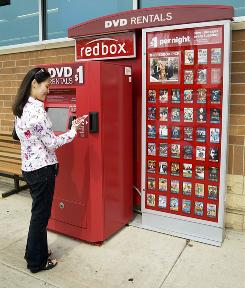 A customer uses a Redbox DVD dispenser. The company has emerged as the largest operator of DVD-rental kiosks.
