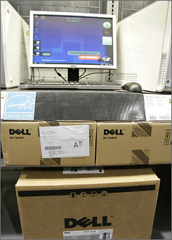 In this May 29, 2008 file photo, Dell computers are on display at Best Buy in Mountain View, Calif. Dell said Tuesday, July 14, 2009, that the U.S. personal computer market has reached its low point but that the timing of a global turnaround in the technology industry remains anyone's guess. 