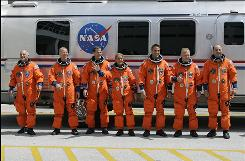 The crew of space shuttle Endeavour, from left, mission specialist David Wolf, flight engineer Timothy Kopra, mission specialist Thomas Marshburn, Canadian Space Agency astronaut Julie Payette, mission specialist Christopher Cassidy, pilot Douglas Hurley and commander Mark Polansky.