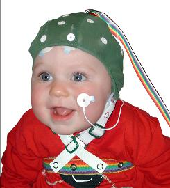 A baby wearing an ERP (event-related potential) cap. The cap has sensors that measure changes in the children's brain as they process stimuli.