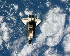 Space Shuttle Endeavour (STS-127) is backdropped by a blue and white Earth, as photographed by an Expedition 20 crew member on the International Space Station soon after the shuttle and station began their post-undocking separation.