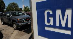 A General Motors made GMC vehicle waits for a buyer at a dealership in Los Angeles. GM and eBay are expected to announce a partnership allowing consumers to haggle over car prices using the online marketplace.