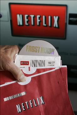 "Netflix customer Arthur Michelson poses the ""Frost Nixon"" DVD he rented from Netflix in front of his television at his home in Palo Alto, Calif., Thursday, July 23, 2009."