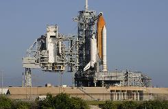 The space shuttle Discovery sits on launch pad 39A at the Kennedy Space Center in Florida.