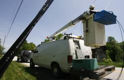 Craig Santos of Eustis Cable in Brookfield, Vt. installs fiber optic cable for Comcast in Ira, Vt., in 2007. The stimulus package championed by the Obama administration set aside up to $350 million to create a national broadband map. That struck some people in the telecommunications industry as excessive.