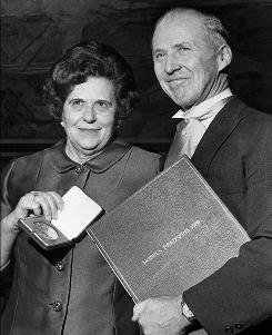 A photo taken on December 14, 1970 in Oslo shows Norman E. Borlaug (R) posing next to his wife Margaret with the Nobel Peace Prize he was awarded with for his work on disease-resistant wheat. Norman Borlaug, a Nobel Prize winning scientist whose work on disease-resistant wheat is credited with saving hundreds of millions of lives, has died at the age of 95 late September 12, 2009 in Dallas.