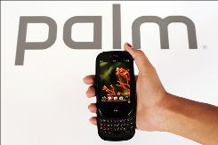 In this May 28, 2009 file photo, the Palm Pre is shown at Palm headquarters in Sunnyvale, Calif. Smart phone maker Palm Inc. on Thursday, Sept. 17, 2009 posted a wider loss for its fiscal first quarter as revenue dropped, but adjusted earnings and sales handily beat Wall Street's expectations.