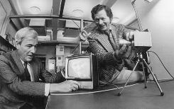 This 1974 handout photo courtesy of Alcatel-Lucent Bell Labs shows Willard Boyle, left, and George Smith with the charge-coupled device, which transforms patterns of light into useful digital information and is the basis for many forms of imaging, including camcorders and satellite surveillance.