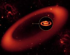 This artist's rendering released by NASA's Jet Propulsion Laboratory shows the biggest but never-before-seen ring around Saturn, spotted by NASA's Spitzer Space Telescope. The inset shows an enlarged image of Saturn, as seen by the W.M. Keck Observatory at Mauna Kea, Hawaii, in infrared light. The bulk of the ring material starts about 3.7 million miles away from the planet and extends outward roughly another 7.4 million miles.