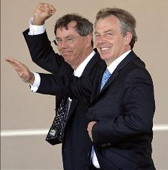In this July 31, 2006 file photo Britain's, then, Prime Minister Tony Blair, right, walks with Arthur Levinson, CEO of Genentech, a biotechnology company, during a visit to their headquarters in San Francisco. Google said Monday, Oct. 12, 2009, board member Arthur Levinson, who is also a director of computer maker Apple is stepping down, removing a potential conflict of interest as the two companies look to compete more directly.