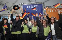 Students of Team Germany react after winning first place overall during the 2009 U.S. Department of Energy Solar Decathlon competition on the National Mall in Washington.