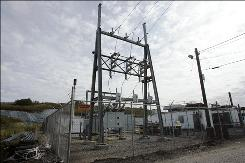 Power lines connected to generators powered by methane gas transfer electricity to the power grid next to the Kingsland landfill in Lyndhurst, N.J., Monday, Oct. 6, 2008.