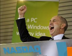 Chris Liddell, CFO of Microsoft Corp., yells as he tries to fire up a crowd of Microsoft employees prior to the start of a rally to celebrate the release of Windows 7 at the Microsoft Campus Thursday, Oct. 22, 2009, in Redmond, Wash. During the gathering Liddell pushed a button to officially start the NASDAQ stock market trading day.