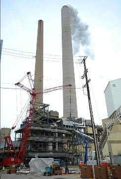 In this April 30, 2009, a carbon dioxide capture system is seen under construction Thursday, April 30, 2009, at American Electric Power's Mountaineer Plant in New Haven, W.Va. 