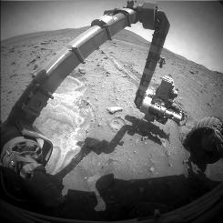 "NASA's Mars Exploration Rover Spirit recorded this forward view of its arm and surroundings on the rover's 2,052nd Martian day Oct. 11, 2009, in this photograph recently released by NASA. Spirit became embedded in soft soil at a site called ""Troy"" five months ago, more than five years into a mission on Mars that was originally scheduled to last for three months."