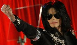 Michael Jackson gestures during a news conference at the O2 Arena in London in March 2009. The pop star's death propelled him to the top of Yahoo search charts in 2009.
