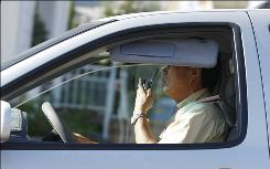 A man talks on his cell phone while driving in Los Angeles, Monday June 30, 2008.