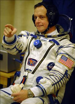 U.S. astronaut Timothy J. Creamer jokes before testing his space suit at Baikonur cosmodrome on December 20, 2009.