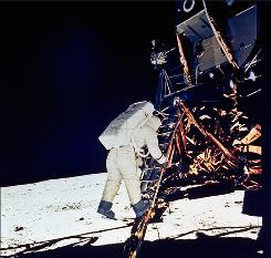 In this July 20, 1969 photo, astronaut Edwin E. Aldrin Jr., descends steps of Lunar Module ladder as he prepares to walk on the moon.
