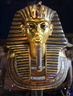 In this Feb. 15, 2010 photo, the golden mask of Egypt's famous King Tutankhamun is displayed at the Egyptian museum in Cairo. Egypt's famed King Tutankhamun suffered from a cleft palate and club foot, likely forcing him to walk with a cane, and died from complications from a broken leg exacerbated by malaria, according to the most extensive study ever of his mummy.