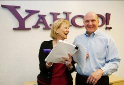 Yahoo Chief Executive Carol Bartz, left, and Microsoft CEO Steve Ballmer, right, smiles at Yahoo headquarters in Sunnyvale, Calif., Wednesday, July 29, 2009.