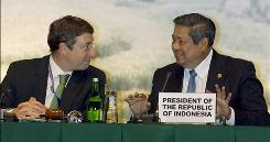 Indonesia President Susilo Bambang Yudhoyono, right, talks to director of the U.N. Environment Program Achim Stiener, left, during an opening ceremony of the 11th special session of the Governing Council/Global Ministerial Environment Forum in Nusa Dua, Bali, Indonesia on Wednesday, Feb 24. 2010. 
