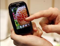 """A Verizon Palm Pre Plus. Palm """"is far from down and out,"""" an industry analyst said after the company slashed revenue forecasts."""