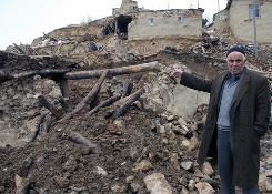 A man shows his destroyed house in the Okcular village in the eastern province of Elazig, Turkey, hours after a strong earthquake early Monday, killing at least 57 people and knocking down houses in at least six small villages, the government said.