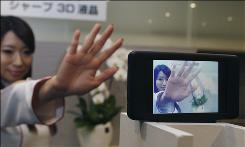 A model's image is shown in the 3D liquid crystal display which is unveiled to the media by Sharp in Tokyo, Japan, Friday, April 2, 2010. Sharp's latest 3D display don't require the cumbersome glasses usually required for such technology.