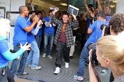 Anthony Campanelli of Los Angeles exits the Apple Store at the Los Angeles Grove shopping center Saturday morning with the first iPad sold. 