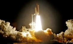 Space shuttle Discovery takes off from the launch pad at Kennedy Space Center.