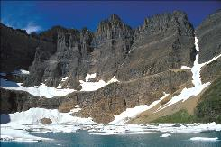 This undated photo provided by the National Park Service shows Iceberg Lake at Glacier National Park, Mt. Scientists on Wednesday, April 7, 2010 said that Glacier National Park has lost two more of its namesake moving icefields to climate change, which is shrinking the rivers of ice until they grind to a halt.