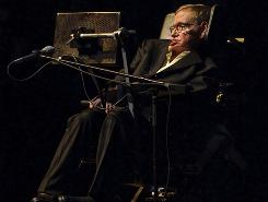 Astrophysicist Stephen Hawking presents a lecture at Texas A&M in College Station, Texas.