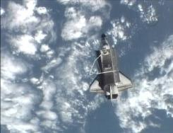 Space shuttle Atlantis moves away from the International Space Station after undocking Sunday and prepares to head back to Earth on its final voyage.