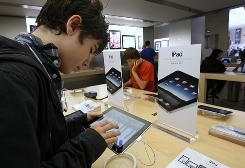 Visitors try the Ipad at the Apple's flagship store in Paris as sales outside the U.S. of the tablet computer began today.