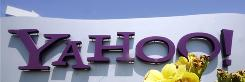 In this 2008 file photo, a sign is in front of the Yahoo offices in Santa Clara, Calif. Yahoo will be unveiling new e-mail features that may change users privacy settings.